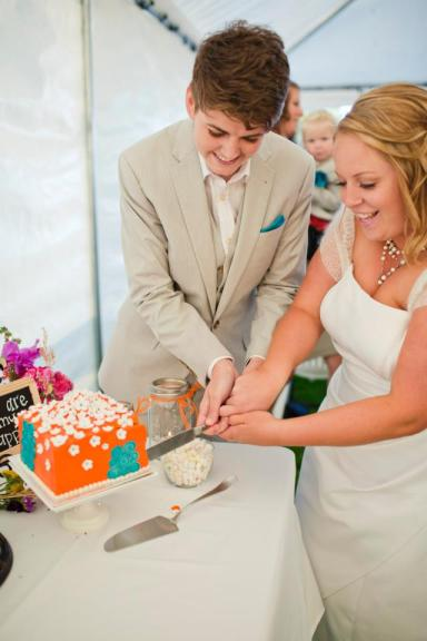 Whitney Young (left) and Marley Blonsky cutting their wedding-day cake on Sep. 9, 2012. Photo by Sunshine Charlie.