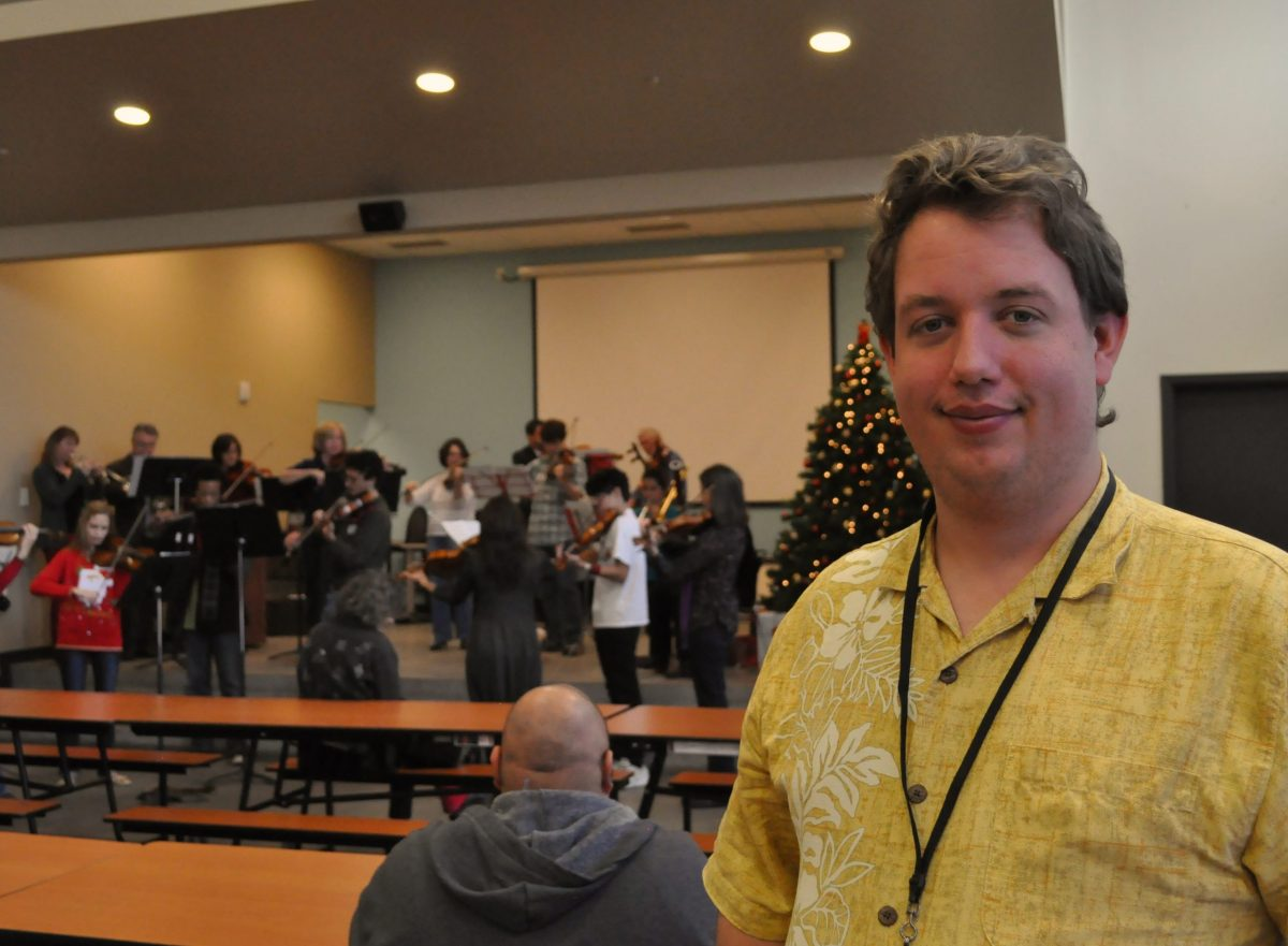 Haven resident Aaron Osivnik enjoying the instrumental carols.