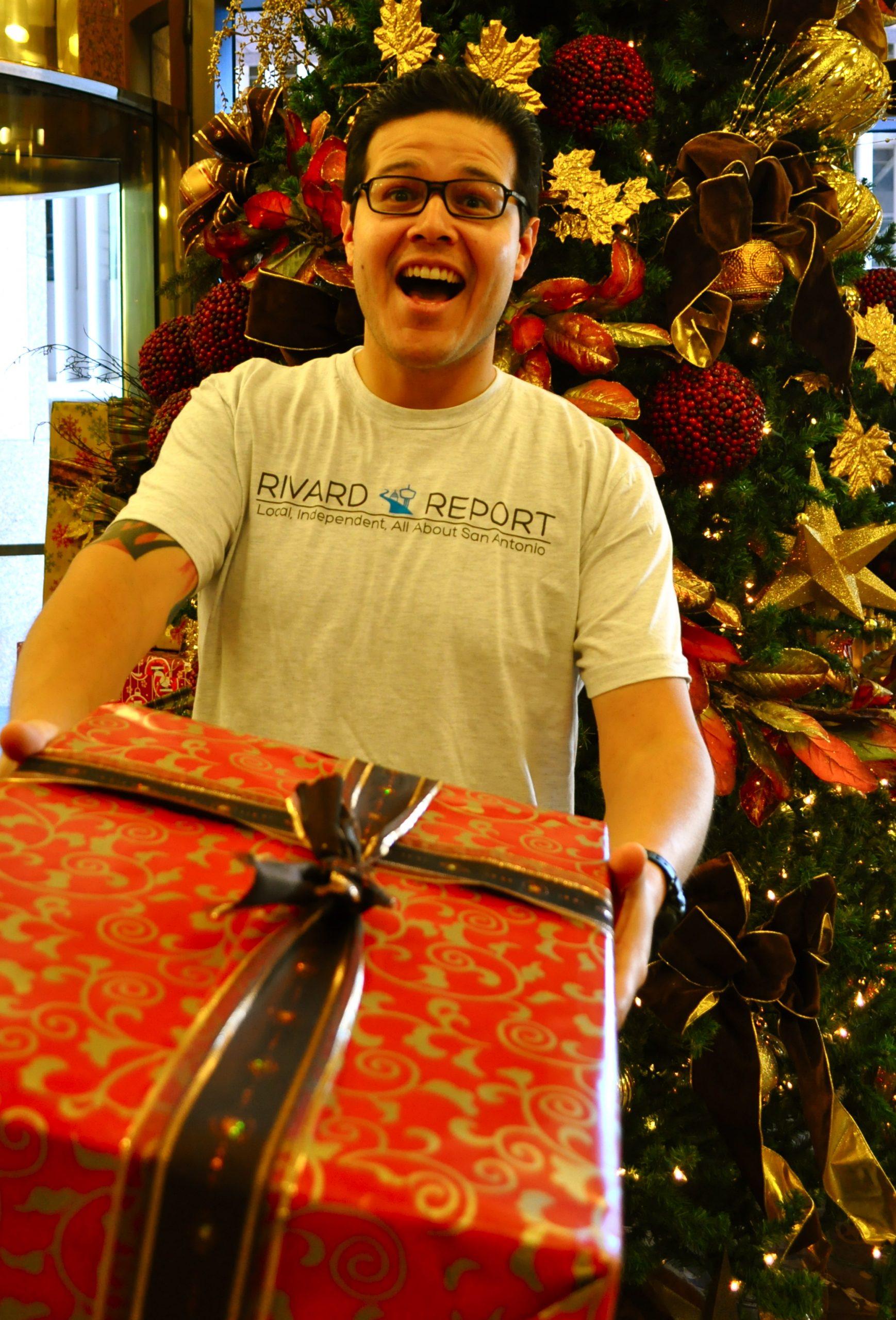 Eddie Romero shows off his Rivard Report T-shirt