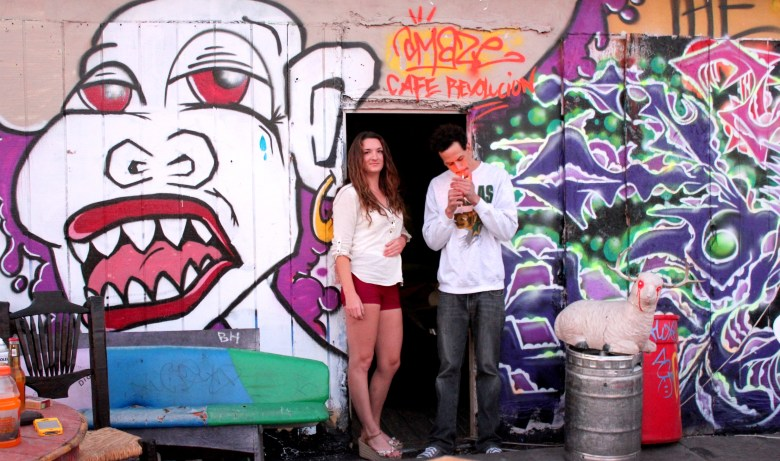 Michelle Yetman and Josiah Boone guard the exit to Cafe's rooftop deck. Photo by Melanie Robinson.