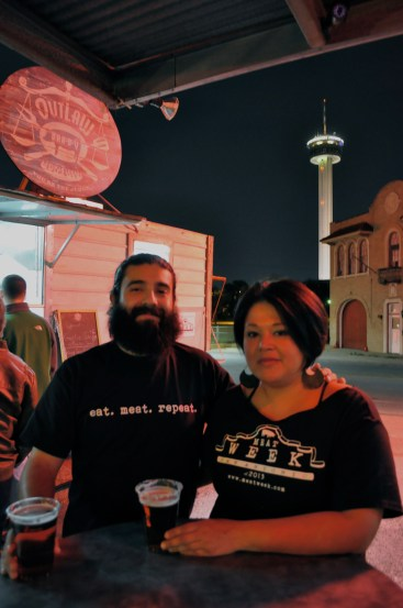 Noel Cisneros and Denise Aguirre enjoy a beer at Alamo Street Eat Bar in front of the featured food truck, Outlaw BarBQ during at Meat Week. Photo by Iris Dimmick.