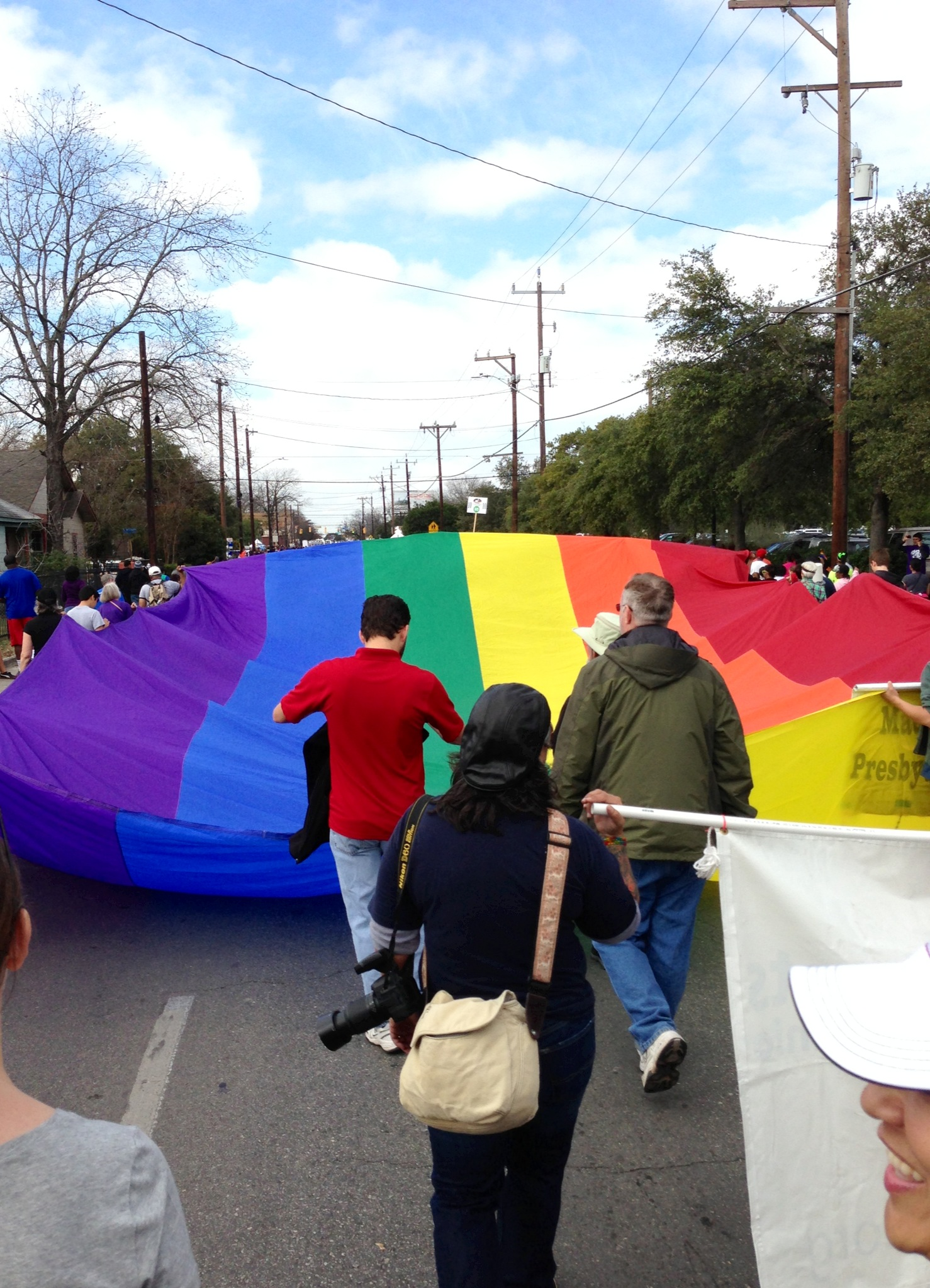 Members of the Madison Square Presbyterian Church carry the Rainbow flag/Freedom flag during the Martin Luther King, Jr. march in 2013. Photo by Lindsay Ratcliffe.