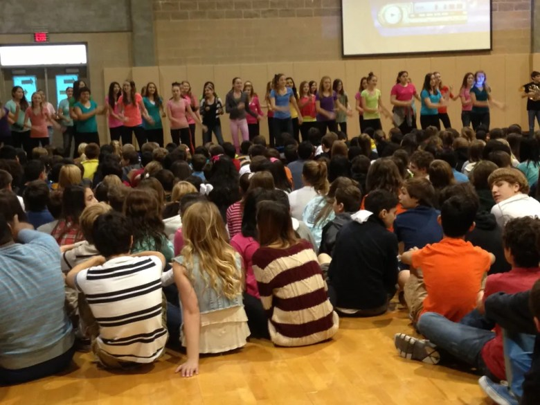 The Lopez MS Choir entertains the crowd at the pep-rally, completely unaware of the surprises to come.
