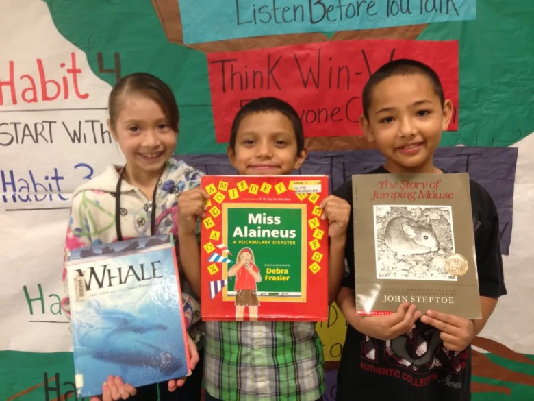 Ariana Gomez, Salvador, and Trent, Spicewood Park Elementary School 2nd graders show off their reading accomplishments.