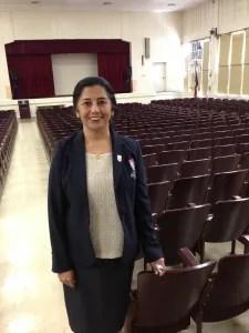 Principal Delia McLerran in the schools auditorium, a labor of love.