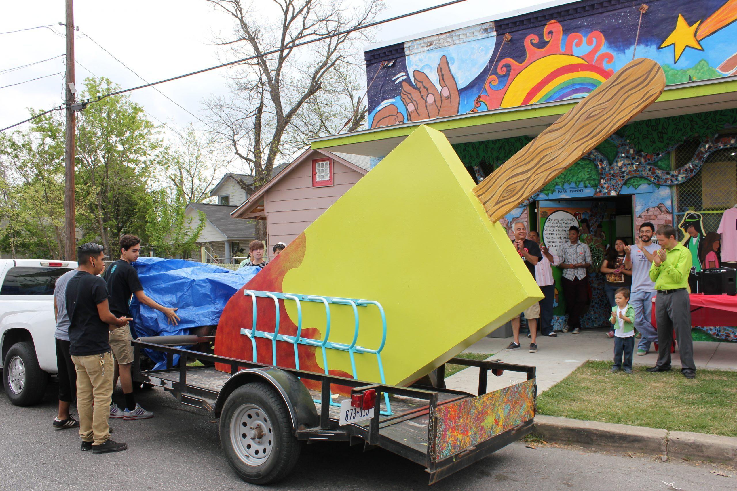San Anto youth participants unveil the tastey treat– an 11 foot tall paleta bike rack. Photo by Melanie Robsinson.