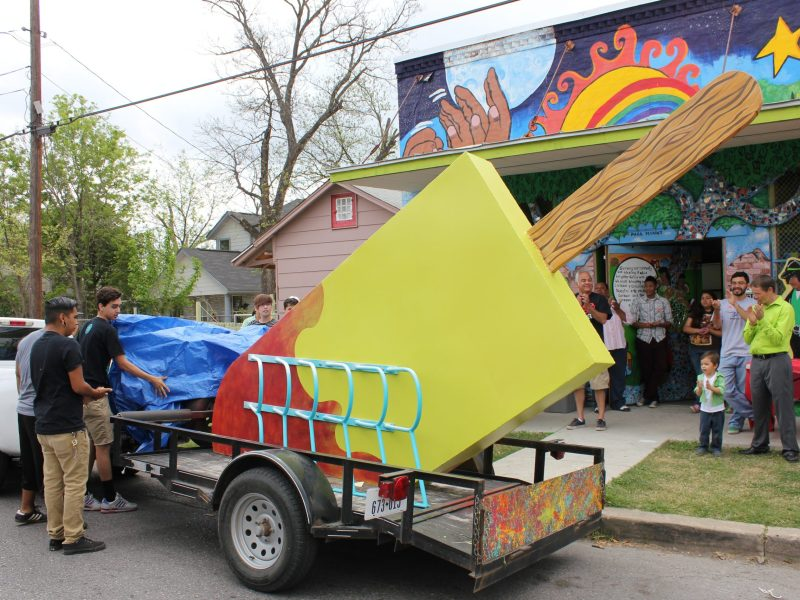 San Anto youth participants unveil the tastey treat– an 11 foot tall paleta bike rack. Photo by Melanie Robsinson.