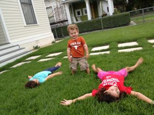 Southtown kids relaxing in the grass during an impromptu Lavaca playdate. Photo courtesy of Caryl Cunningham Teten