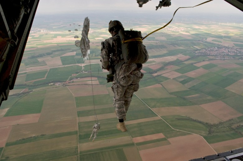 U.S. Army paratroopers from the 5th Quartermaster Detachment, 21st Special Troops Battalion, 21st Theater Sustainment Command exit a C-130J Hercules aircraft during an airdrop training mission at the Mannheim drop zone, Germany, April 14, 2011.  The single C-130J aircraft from the 37th Airlift Squadron, 86th Airlift Wing will drop more than forty service members at the drop zone.  U.S. Air Force photo/TSgt Wayne Clark, AFNE Regional News Bureau.