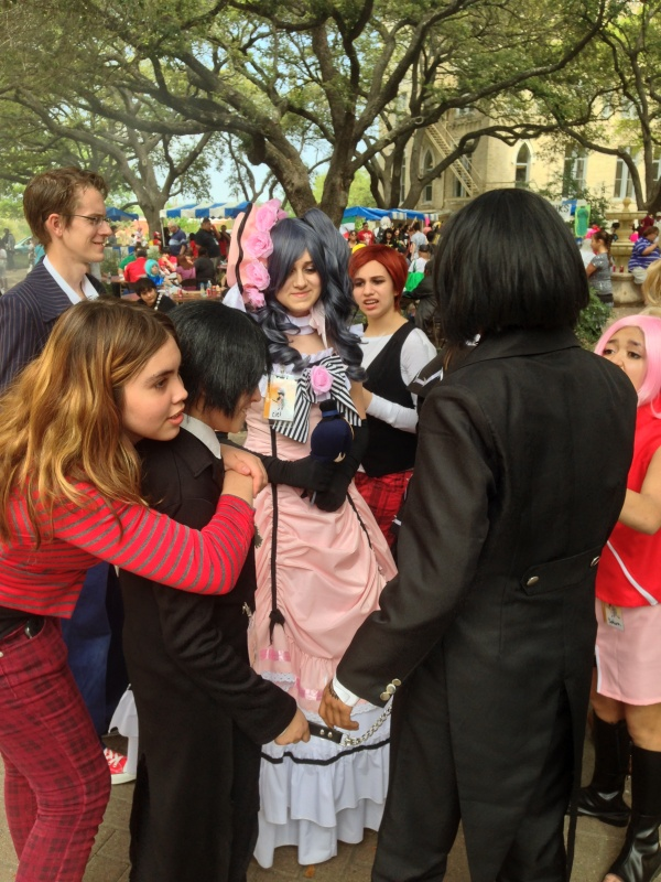 An especially detailed costume gets extra attention at the anime convention.
