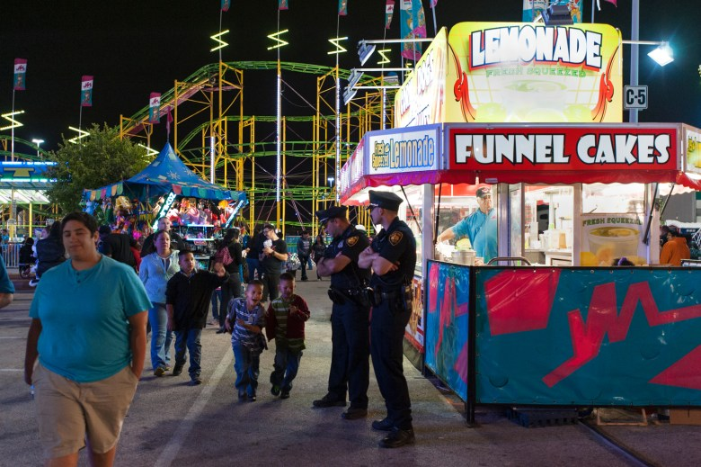 San Antonio Police Officer Shaun Preyer-Johnson and Detective Schoenberger patrol the south end of Carnival on Thursday night. Photo by Corey Leamon.