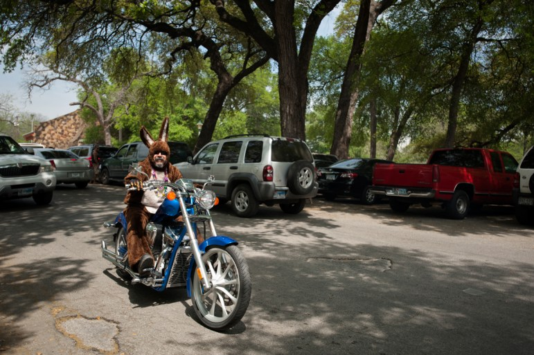 The Easter Bunny pays families at Brackenridge Park a visit. Photo by Corey Leamon.