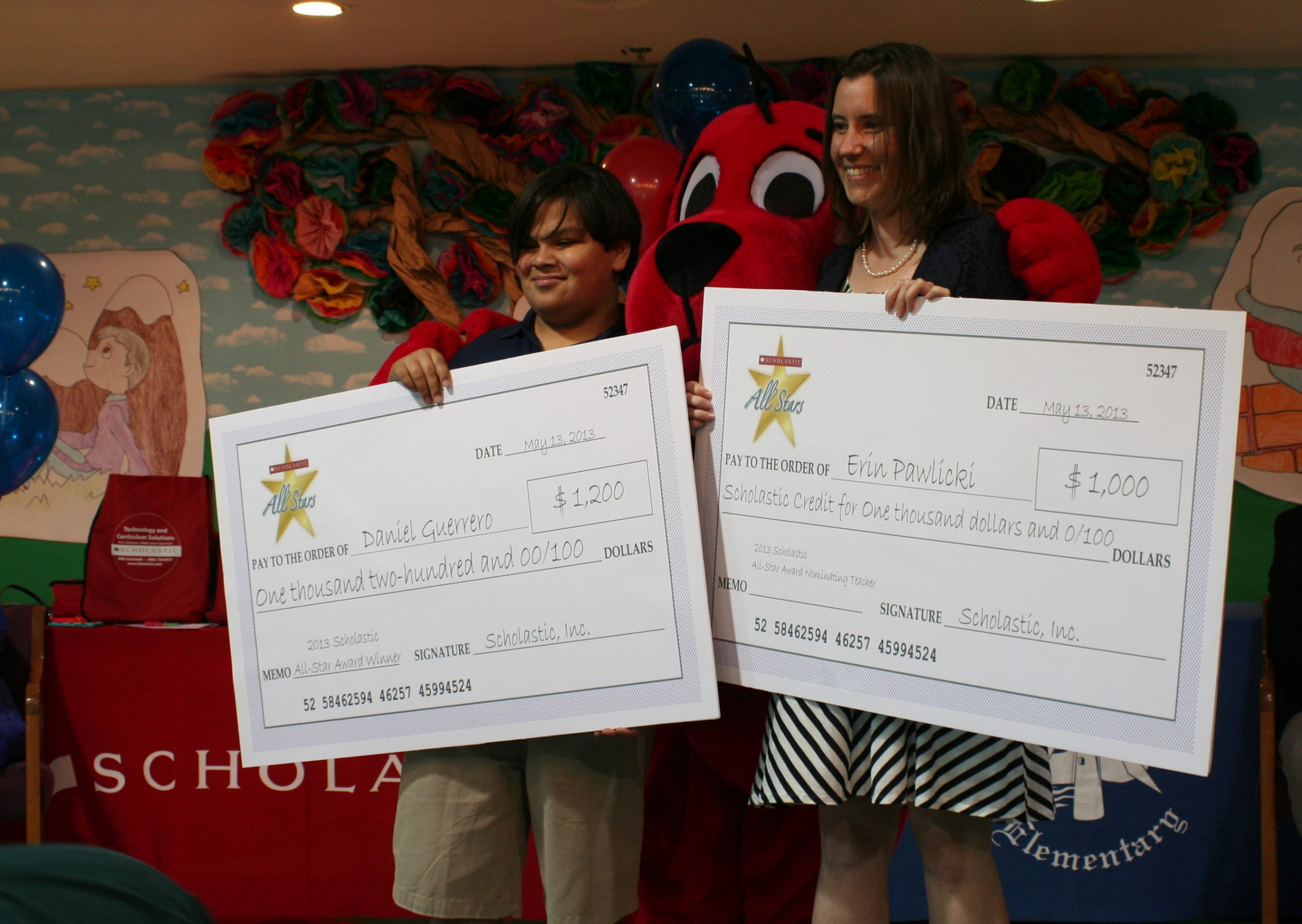 Daniel Guerrero, left, Scholastics All-Star, received $1,200. His reading teacher, Erin Pawlicki was given a $1,000 voucher for Scholastics products to use in her classroom. Photo courtesy of SAISD