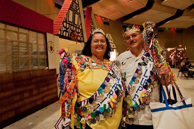 A local couple displays their Fiesta pride at A Night in Old San Antonio (NIOSA) in 2012. Photo by Corey Leamon.