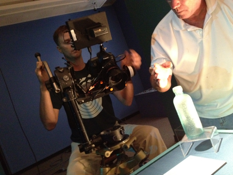 Adam Stielstra, creative director for the SARA's San Antonio River Documentary, operates the high-tech camera used to film artifacts found in the river, preserved at the Witte Museum. Photo courtesy of SARA.
