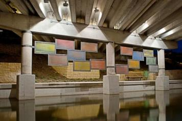 """San Antonio artist Stuart Allen's installations under the twin underpasses at McCullough and Brooklyn Avenue. Allen's minimalist suspended panels appear to shift and morph with changing patterns of color and texture as visitors walk past or float by."" Photo courtesy of the San Antonio River Foundation."