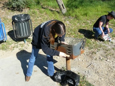 A volunteer cleans a barbecue grill at the Japanese Tea Garden. Photo courtesy of Parks and Recreation, City of San Antonio.
