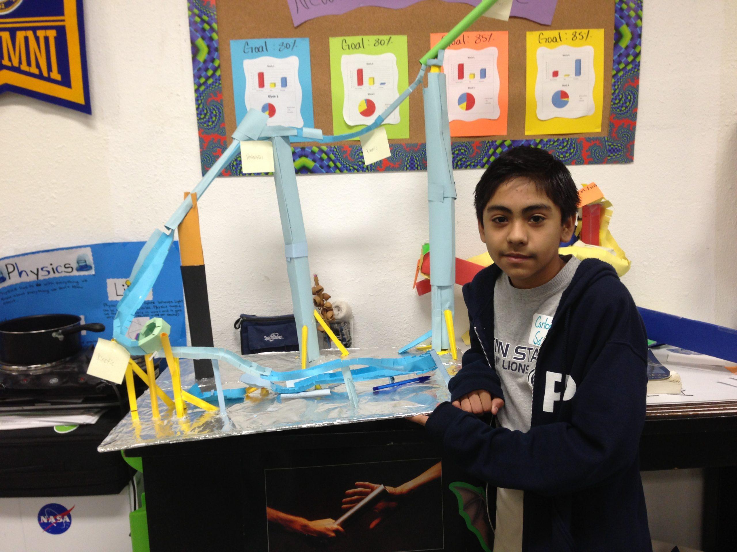 Carlos Sanchez shows off his physics roller coaster at KIPP Aspire. Photo by Bekah McNeel.