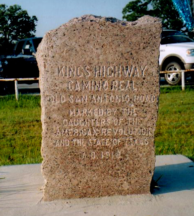 A 1918 pink granite marker for the Old San Antonio Road located outside of Bastrop, TX, photo courtesy of Larry D. More.