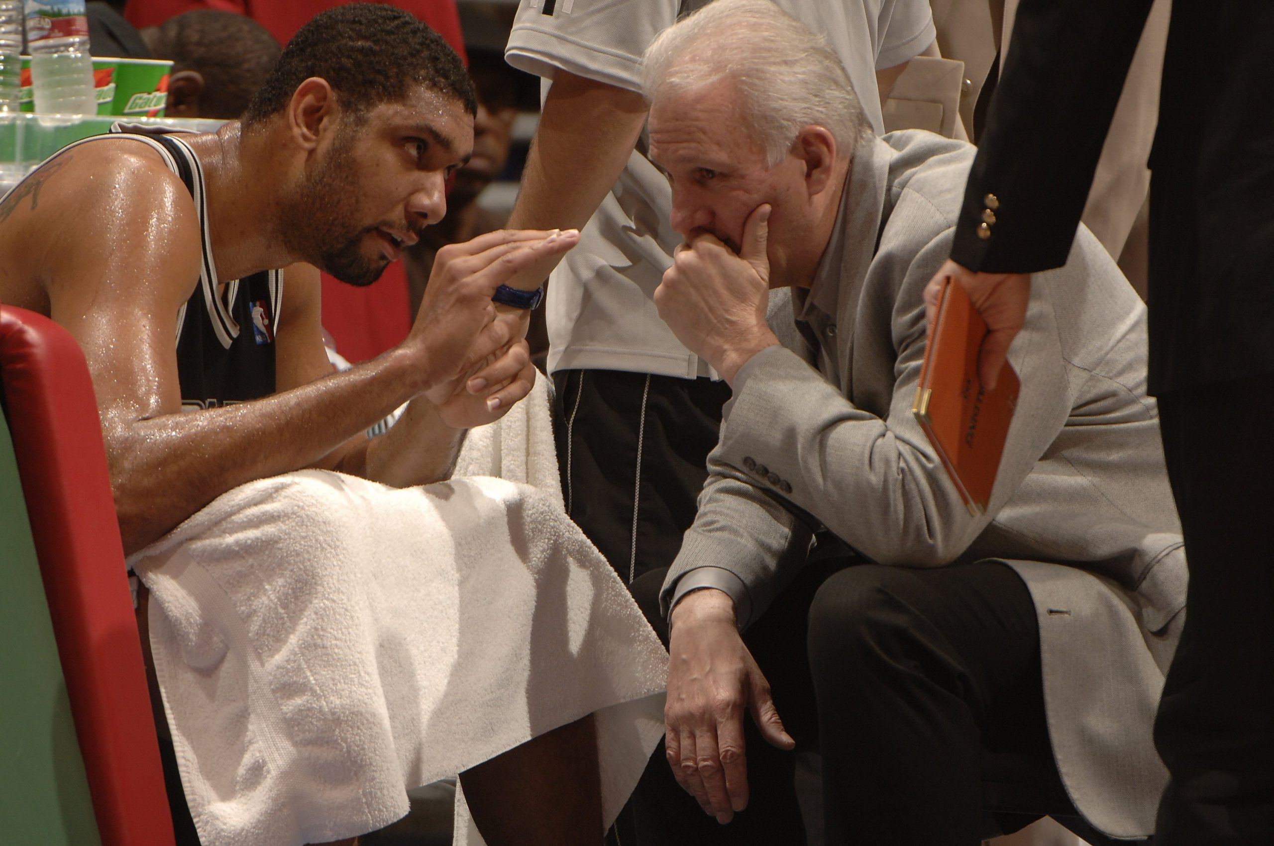 Tim Duncan, #21, of the Spurs talks with Head Coach Gregg Popovich during a game against the Los Angeles Clippers in 2006 in Los Angeles, California. Photo courtesy of San Antonio Spurs (Getty).