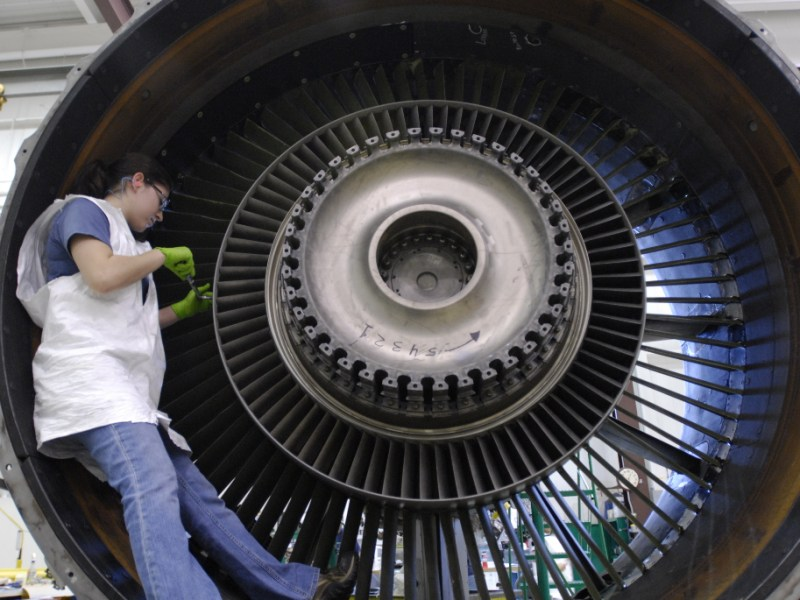 Annette Enriquez works on a jet engine. Annette completed her bachelor's degree from Embry-Riddle University, she'll be pursuing her masters with no college debt. Photo courtesy of Alamo Academies.