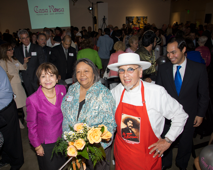 TAMUSA President Maria Ferrier stands with the woman of the hour, Rosie Castro, and Jorge Cortez as Rosie's son, Major Julian Castro looks on. Photo by Al Rendon.