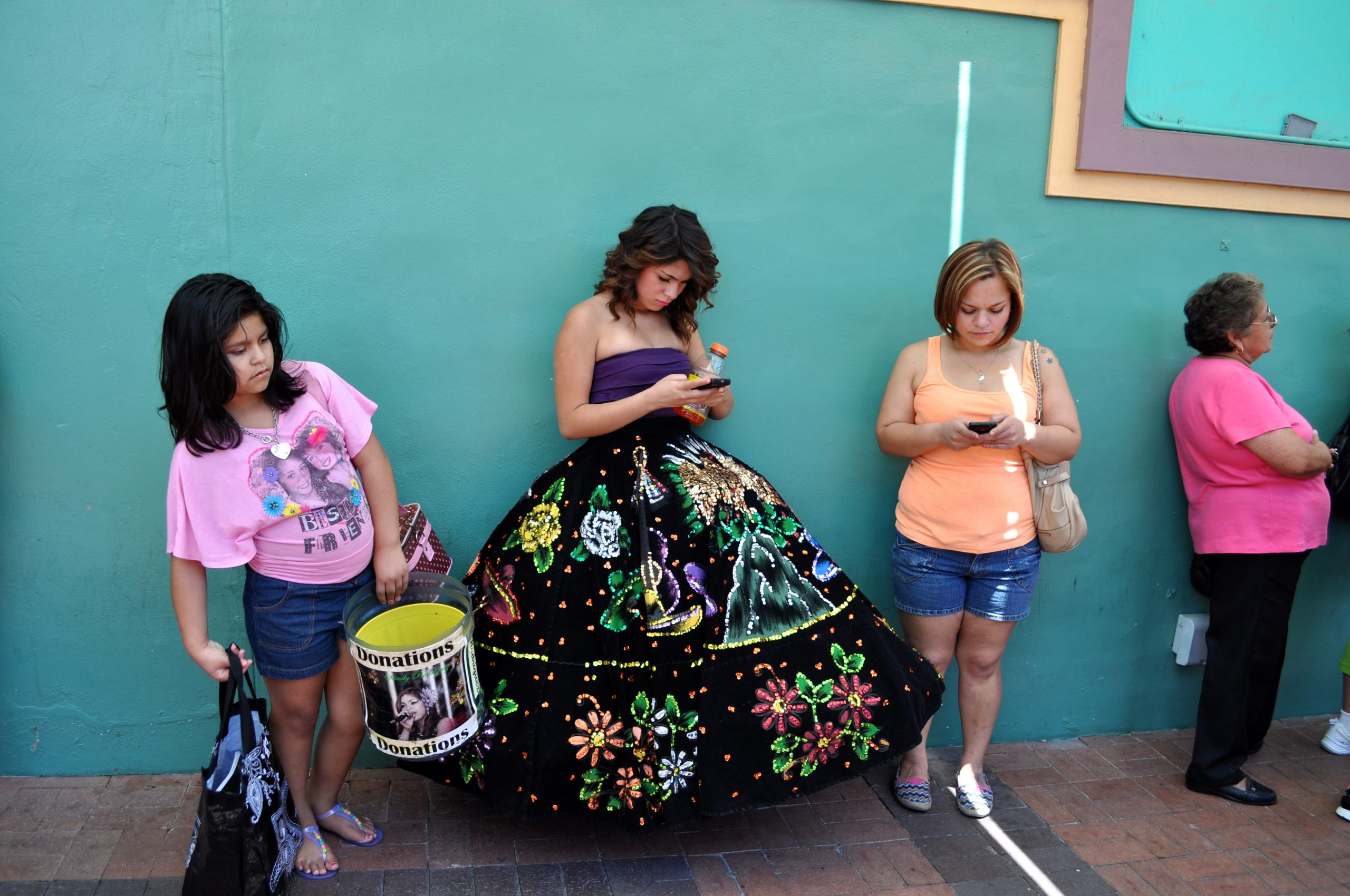 A young latina singer awaits her turn to sing at the 2013 Cinco De Mayo Celebrations in Market Square - El Mercado. Photo by Iris Dimmick.