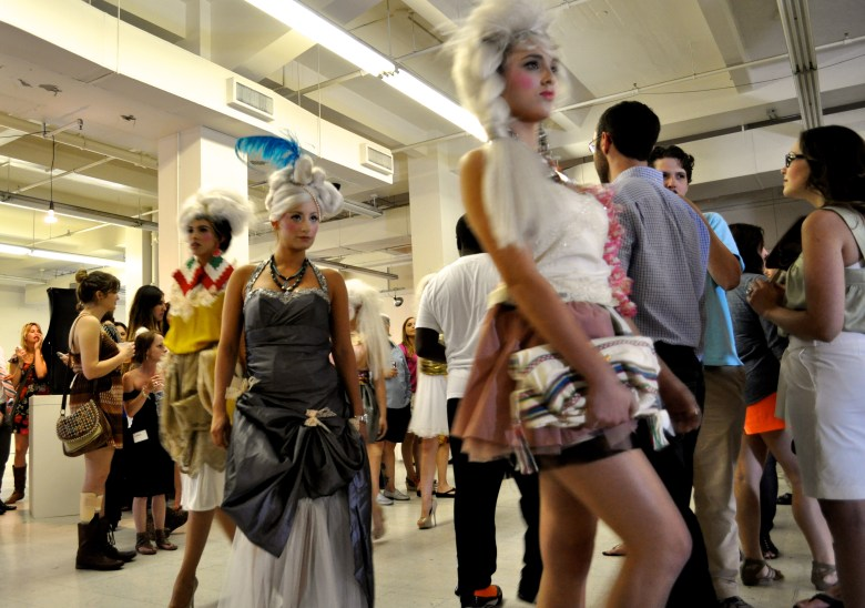 Fashion models wear the work of local designer Agosto Cuellar while they weave through the crowd gathered at the Center City Open House. Photo by Iris Dimmick.