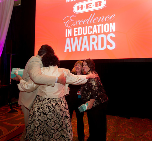 Winners of the H-E-B Excellence in Education grants share and emotional hug during the award ceremony last night in Austin, May 3, 2013. Photo courtesy of H-E-B.