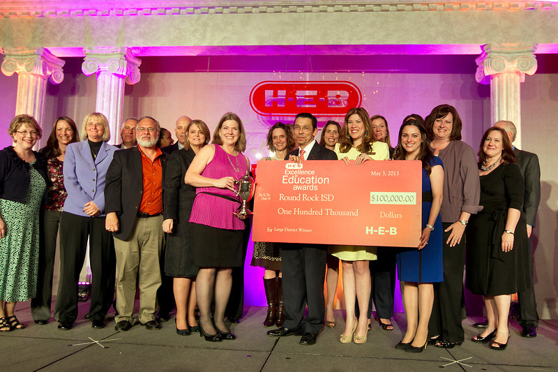 Superintendent Dr. Jesus Chavez and teachers and administrators from Round Rock ISD accept a $100,000 grant as the winner in the Large School District category of the H-E-B Excellence in Education awards.. Photo Courtesy of H-E-B.