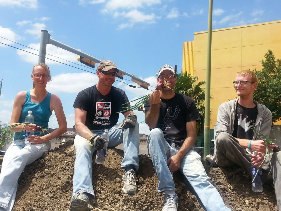 Volunteers at the Little Patch Garden relax on a pile of freshly delivered dirt. From Left: Katie Lee, Tom Hoffman, Steve Flannery, Ethan Jones. Photo by Dianne Tingle.