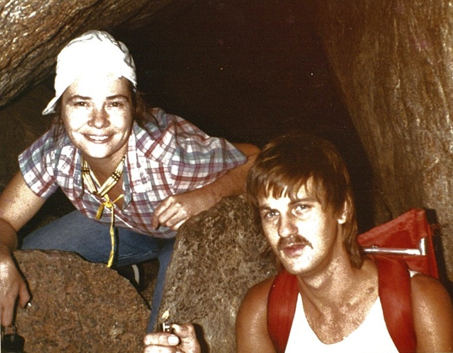 Gail Pollock and Steve Wisnoski demonstrate the need for loose clothing inside a chamber (1984).