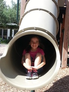 Zoe has fun on the slide at Landa Library and playground. Photo by Georgina Morgan.