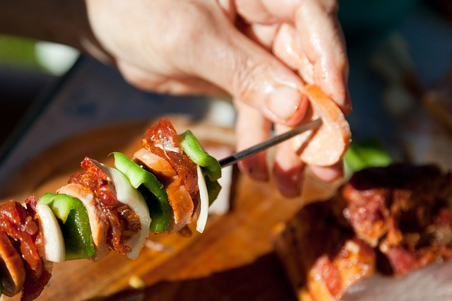 Shish Kebabs are perfect for limiting the amount of dishes or trash from paper plates from you next big barbeque. Public domain photo.