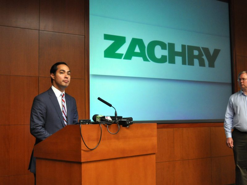 Rackspace Chairman and Co-founder Graham Weston looks on as Major Julián Castro (left) address the small crowd gathered at Zachry Holdings Inc. headquarters about the importance of immigration reform to the business community and local industry. Photo by Iris Dimmick.