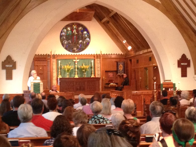 Kay Karcher Mijangos addresses the St. Paul's community at a service held in her honor.