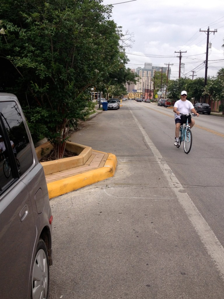 This South Alamo Street landscaping amenity actually inhibits safe cycling. A smaller planter separating vehicle traffic from a secure bike lane would be better. Photo by Robert Rivard