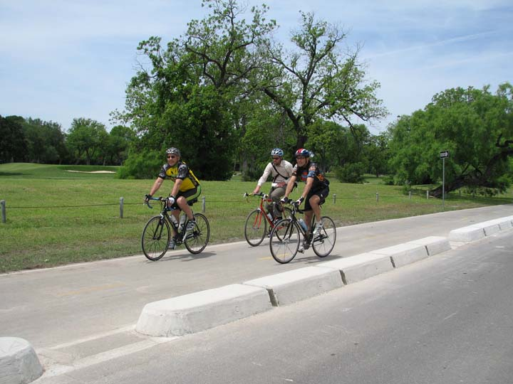 The author, Express-News reporter Colin McDonald and Richard Varn, a former city official on a cycle track next to Brackenridge Golf Course. Photo courtesy of COSA/Office of Sustainability