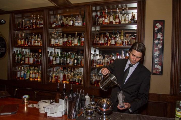 Jordan Corney prepares a cocktail at Bonanan's, 222 E. Houston. Photo by Steven Starnes.