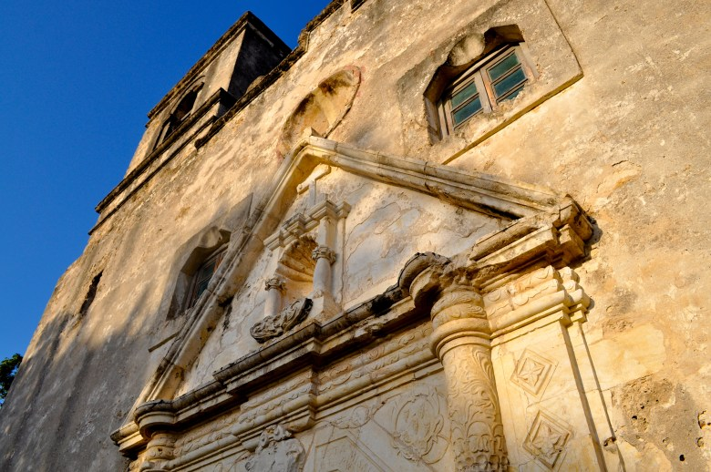 Mission Conceción's facade. The bright, colorful patterns have worn off during 300 years of weather and wind erosion. Photo by Iris Dimmick.