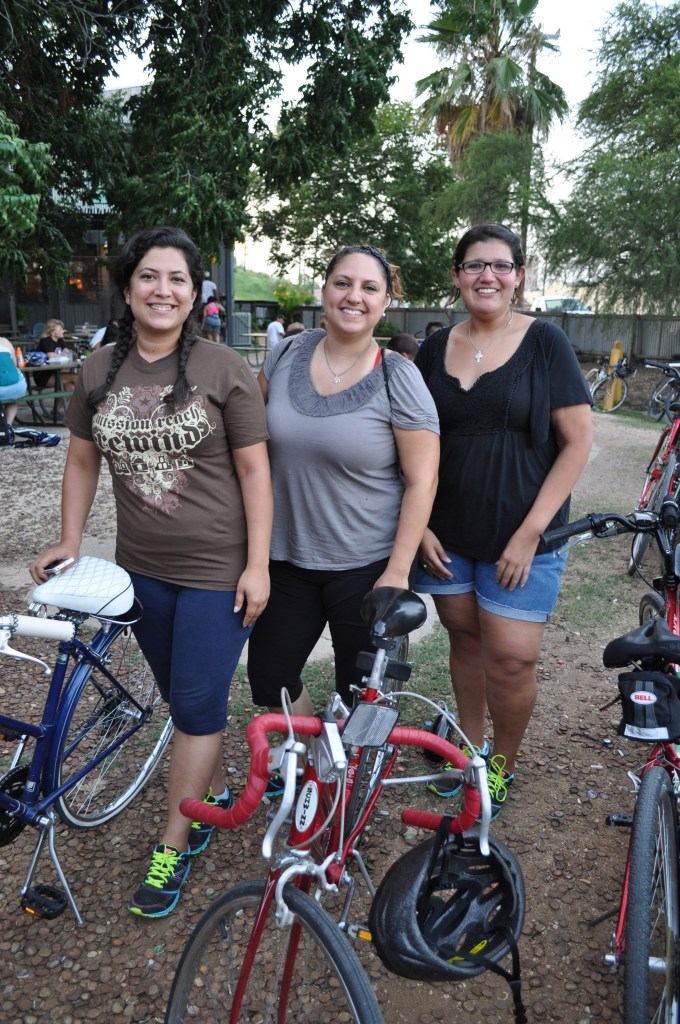 Kara Leyva, Kayla Martinez, and Kim Olsen pose for a photo with their bikes and matching shoes after the Something Monday ride and educational presentation on the Mission Reach. Photo by  Iris Dimmick.