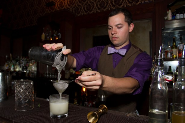 """Stephan Mendez expertly crafts a  """"Texecutioner"""" cocktail. Photo by Steven Starnes."""