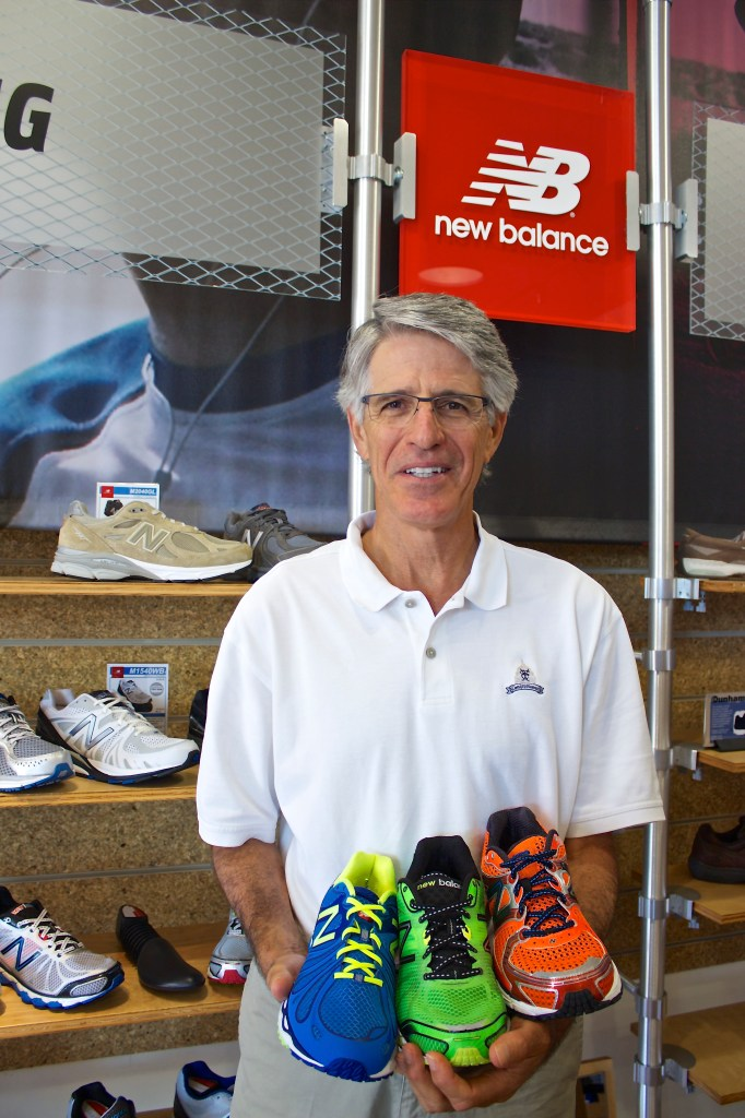 Rob Kaufman, owner of New Balance San Antonio, with a sampling of shoes from his store at the Quarry Village.