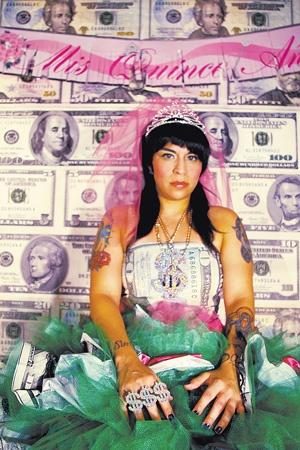 Dressed in all green, Mari Hernandez celebrates her overdue quinceañera. Courtesy photo.