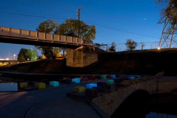 """Mark Schlesinger's installation, """"Up on the On"""" on the Mission Reach near Roosevelt Park. Eight of the blocks glow in the dark. Photo by Mark Menjivar."""