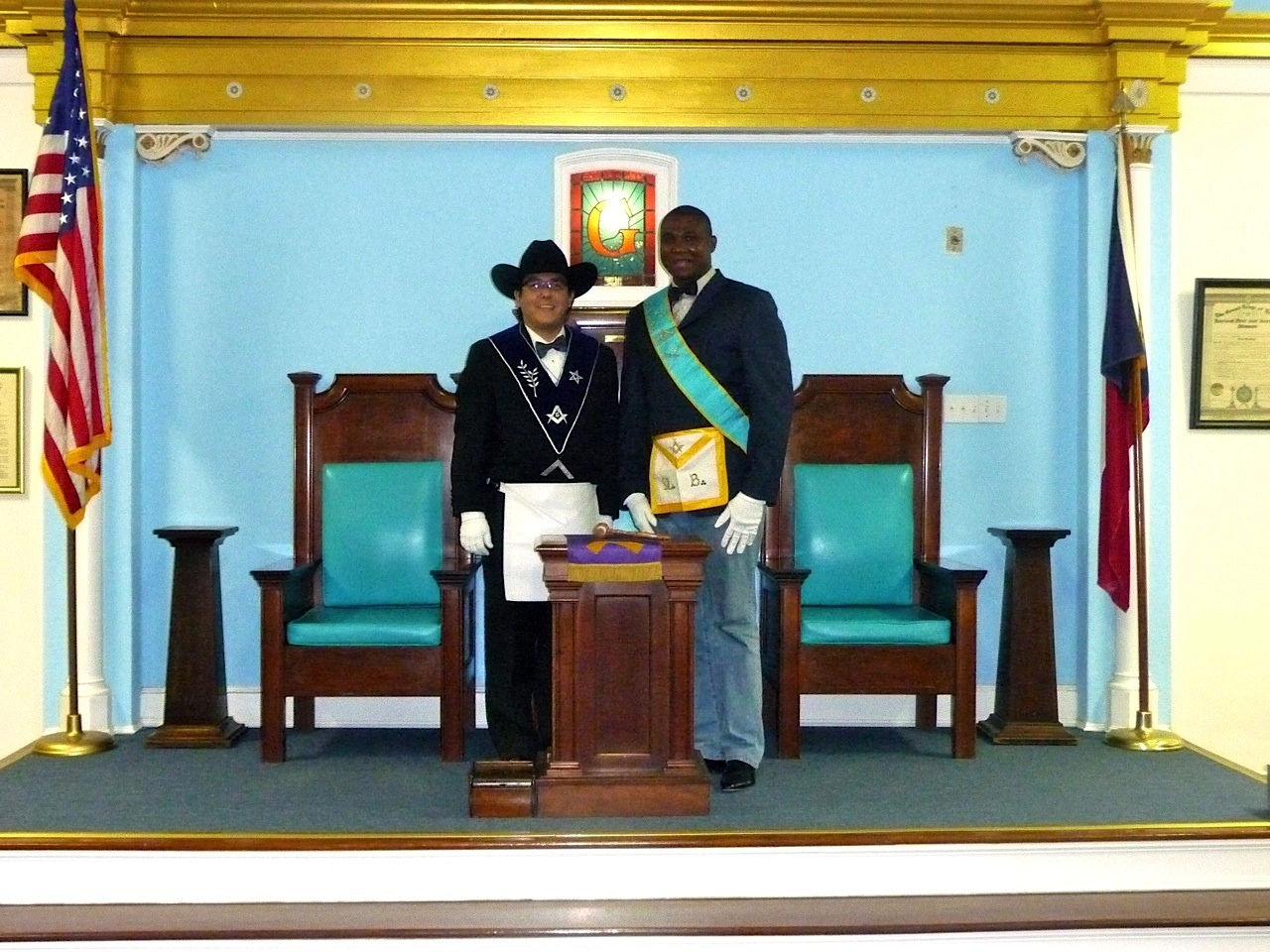 A photo of me (in cowboy hat) as Master of Merit Masonic Lodge No. 727 with a visiting Mason from Benin. Photo courtesy of James Rodriguez.