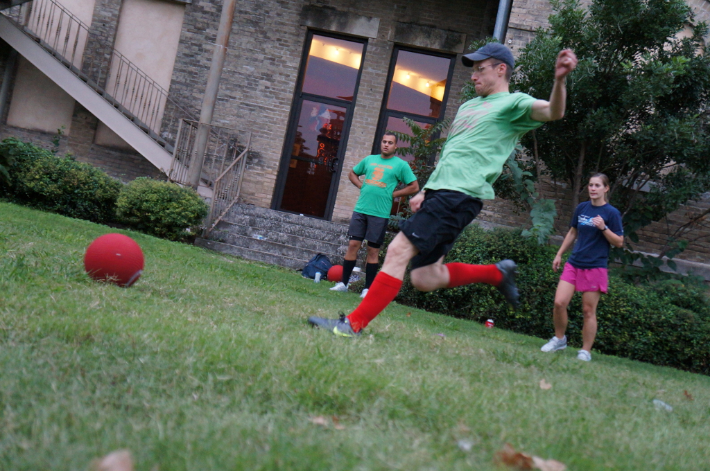 Scott Gustafson winds up for a kick while teammates and opponents look on. Photo by Vanessa Mulholland.