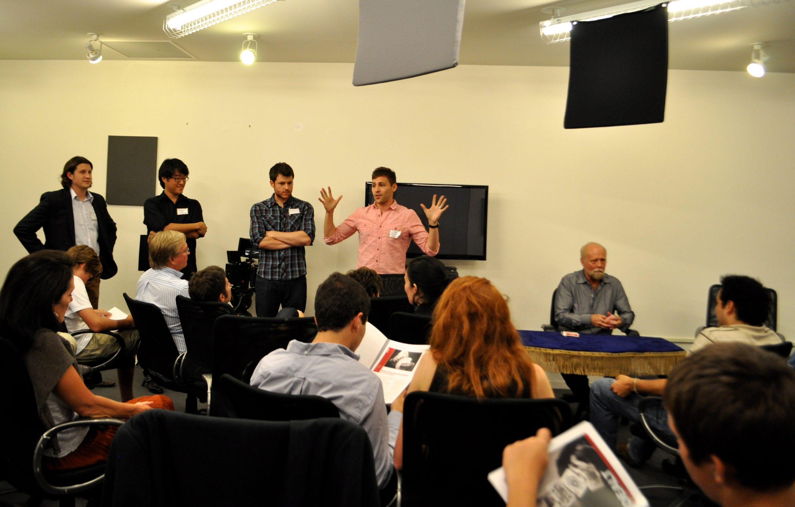 """The """"Dealt"""" crew pitches the film to investors at Geekdom with Richard Turner, card mechanic (right). From left: Producer Russell Wayne Groves, Producer Andrew Lee, Writer Bradley Jackson, and Director Luke Korem. Photo by Iris Dimmick."""