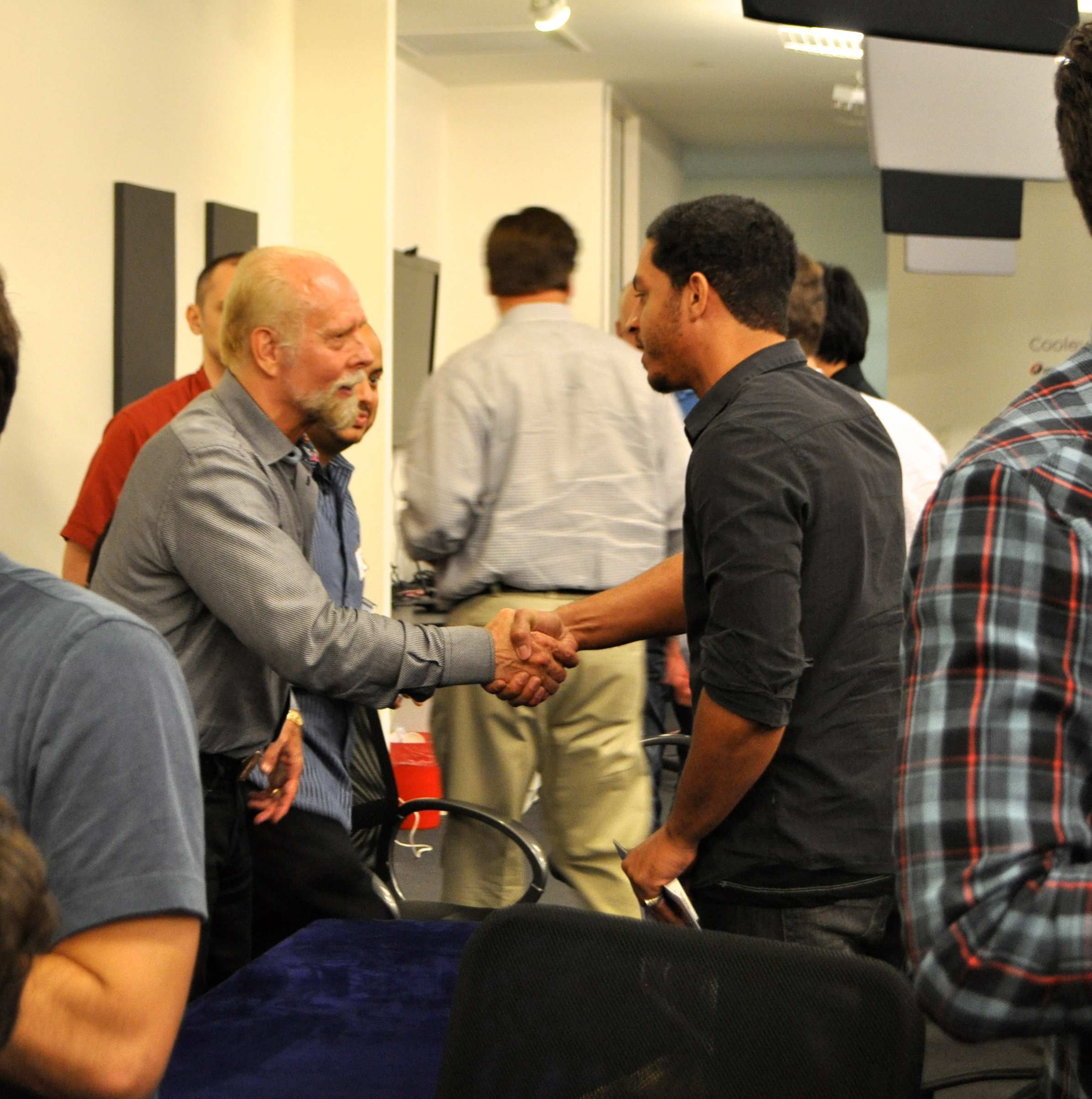 Richard Turner shakes hands with an audience member at the private event at Geekdom last week. Photo by Iris Dimmick.