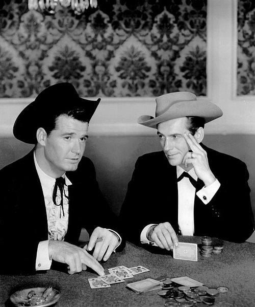 """James Garner (left) and Jack Kelly portraying Old West card sharks in the television series, """"Maverick."""" Public Domain photo."""